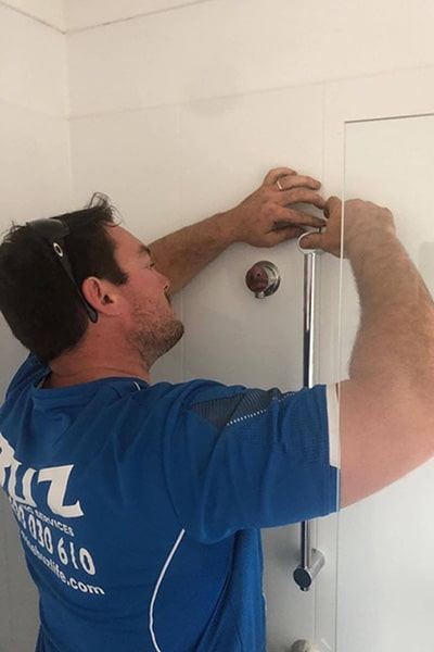 Man doing plumbing duties in Redcliffe